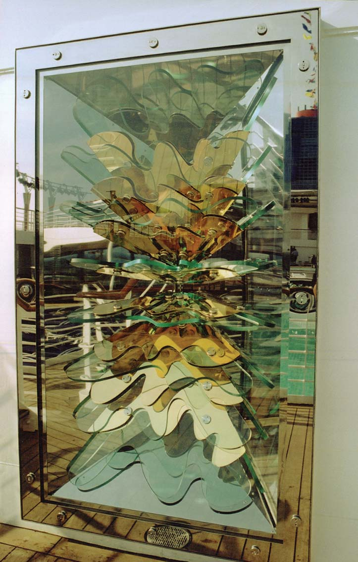 Stainless steel, glass and light, decorative panel for Royal Caribbean Cruise Line. Designers: Simon Moss/Peter Layton Associates
